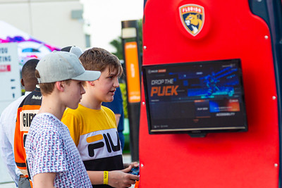 Two kids play an NHL video game on the Jet Blue Tarmac at the BB&T Center in Sunrise, FL on Thursday, February 13, 2020 where the Florida Panthers hosted the Philadelphia Flyers. The Flyers went on to beat the Panthers 6-2. [JOSEPH FORZANO/palmbeachpost.com]