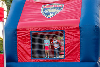 Two kids have fun in the bounce house on the Jet Blue Tarmac at the BB&T Center in Sunrise, FL on Thursday, February 13, 2020 where the Florida Panthers hosted the Philadelphia Flyers. The Flyers went on to beat the Panthers 6-2. [JOSEPH FORZANO/palmbeachpost.com]