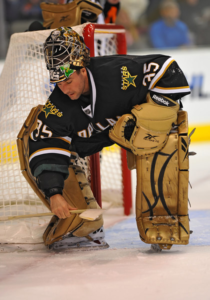 Dec 31st, 2009:  <br /> Dallas Stars goalie Marty Turco #35 picks up his gear after getting hit by a puck in a game between the Anaheim Ducks and the Dallas Stars at the AAC in Dallas, Texas.<br /> Stars win 5-3