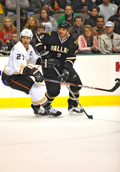Dec 31st, 2009:  <br /> Anaheim Ducks defenseman Scott Niedermayer #27 & Dallas Stars center Mike Modano #9 battle for the puck in a game between the Anaheim Ducks and the Dallas Stars at the AAC in Dallas, Texas.<br /> Stars win 5-3