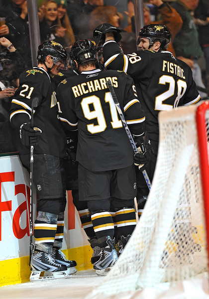 Dec 31st, 2009:  <br /> Dallas Stars left wing Loui Eriksson #21 gets 3-goals (hat trick) and is congratulated by his teammates in a game between the Anaheim Ducks and the Dallas Stars at the AAC in Dallas, Texas.<br /> Stars win 5-3