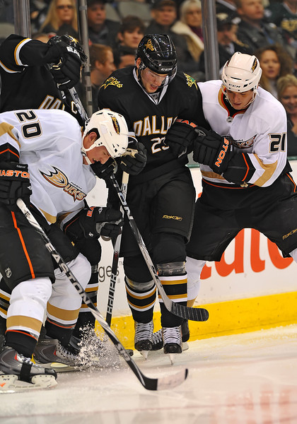 Dec 31st, 2009:  <br /> Anaheim Ducks defenseman Sheldon Brookbank #21 & Anaheim Ducks center Ryan Carter #20 fight off Dallas Stars center Tom Wandell #23 for a loose puck in a game between the Anaheim Ducks and the Dallas Stars at the AAC in Dallas, Texas.<br /> Stars win 5-3