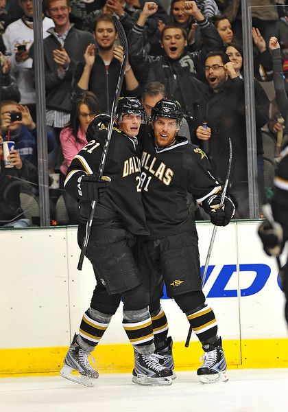 Dec 31st, 2009:  <br /> Dallas Stars center Brad Richards #91<br /> gets two assist while he is congratulated by Dallas Stars left wing Loui Eriksson #21 for helping him get a hat trick in a game between the Anaheim Ducks and the Dallas Stars at the AAC in Dallas, Texas.<br /> Stars win 5-3