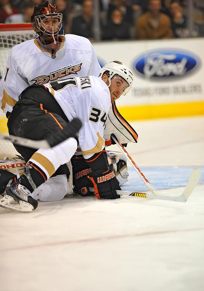 Dec 31st, 2009:  <br /> Anaheim Ducks defenseman James Wisniewski #34 helps protect the puck in a game between the Anaheim Ducks and the Dallas Stars at the AAC in Dallas, Texas.<br /> Stars win 5-3