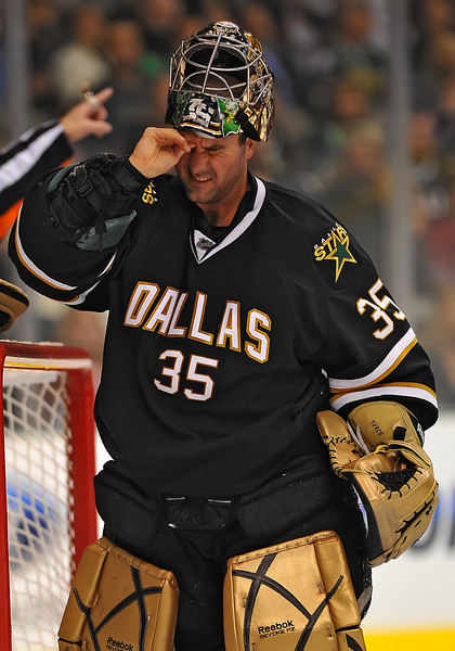 Dec 31st, 2009:  <br /> Dallas Stars goalie Marty Turco #35 rubs his right head/eye after getting hit by a puck in a game between the Anaheim Ducks and the Dallas Stars at the AAC in Dallas, Texas.<br /> Stars win 5-3