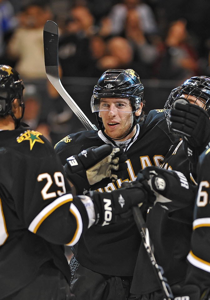 Dec 31st, 2009:  <br /> Dallas Stars left wing James Neal #18 gets an assist while teammates congratulate each other in a game between the Anaheim Ducks and the Dallas Stars at the AAC in Dallas, Texas.<br /> Stars win 5-3