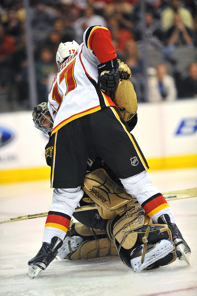 November 4th, 2009:  <br /> Dallas Stars goalie Marty Turco (35) gets fouled during a game between the Calgary Flames and the Dallas Stars at the AAC in Dallas, Texas.  <br /> Calgary beats Dallas in OT 3-2