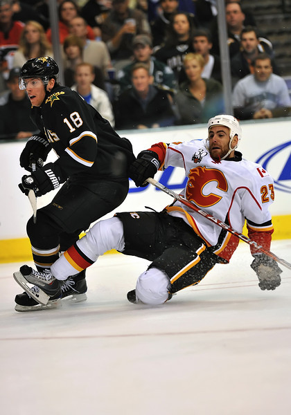 November 4th, 2009:  <br /> Calgary Flames left wing Eric Nystrom & (23) Dallas Stars left wing James Neal (18) in action during a game between the Calgary Flames and the Dallas Stars at the AAC in Dallas, Texas.  <br /> Calgary beats Dallas in OT 3-2
