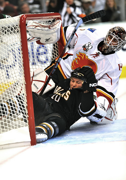 November 4th, 2009:  <br /> Dallas Stars left wing Brenden Morrow (10) pushed onto the Calgary Goalie during a game between the Calgary Flames and the Dallas Stars at the AAC in Dallas, Texas.  Calgary beats Dallas in OT 3-2