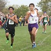 Edsel Ford's Mohammed Munassar (left) was seventh overall in 16:50.50. Lake Erie Metropark hosted the annual high school boys' cross country Regional on Saturday, Oct. 29, 2016. (MiPrepZone photo gallery by Terry Jacoby)