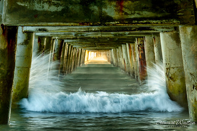 Crashing waves under Tolaga Bay Wharf