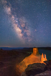 The Milky Way at twilight. The towers were lit with a powerful spotlight during a 20-second exposure. Marlboro Point northwest of Moab, Utah.