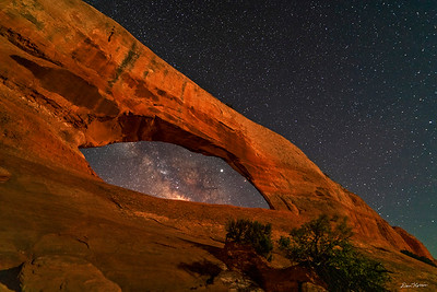 Wilson Arch and the Milky Way Galaxy.  Highway 191 south of Moab.  Light from the crescent moon and passing cars.