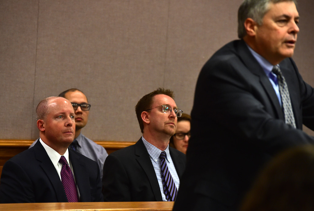""". Erie Town Administrator Arthur \""""A.J.\"""" Krieger, left, and Fred Diehl, Assistant to the Town Administrator, listen to attorney  Donald Ostrander make an opening statement for the city of Lafayette  in a hearing over the lawsuit over the Nine Mile Corner development on the border between Lafayette and Erie at the Boulder County Justice Center on Tuesday.  For more photos go to www.dailycamera.com Paul Aiken Staff Photographer Feb 13 2017"""