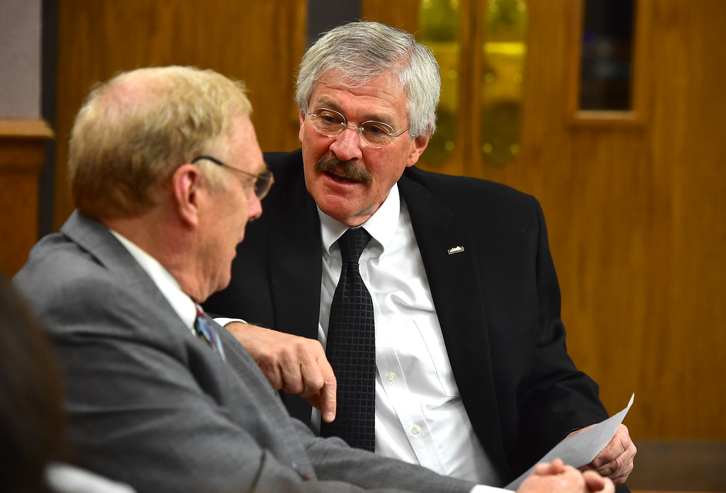 . Lafayette City Administrator Gary Klaphake, right, consults with attorney David Williamson during a hearing over the lawsuit over the Nine Mile Corner development on the border between Lafayette and Erie at the Boulder County Justice Center on Tuesday. For more photos go to www.dailycamera.com Paul Aiken Staff Photographer Feb 13 2017