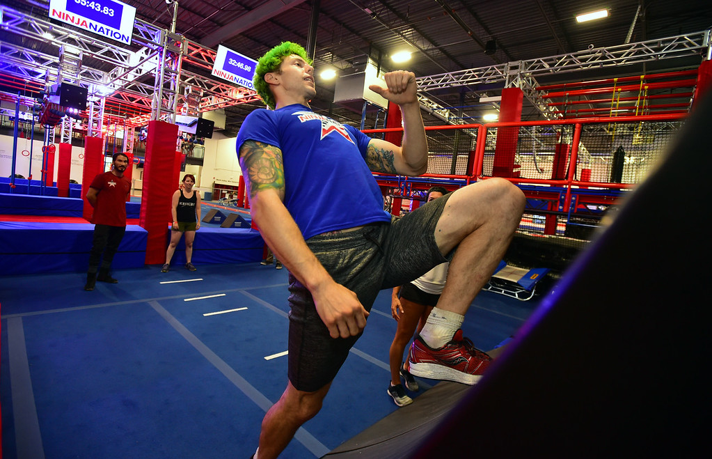 . Instructor Jamie Rahn demonstrates the improper way to run up the Warped Wall during the Adult Intro Class at Ninja Nation in Lafayette on Thursday.  Paul Aiken / Staff Photographer July 5, 2018