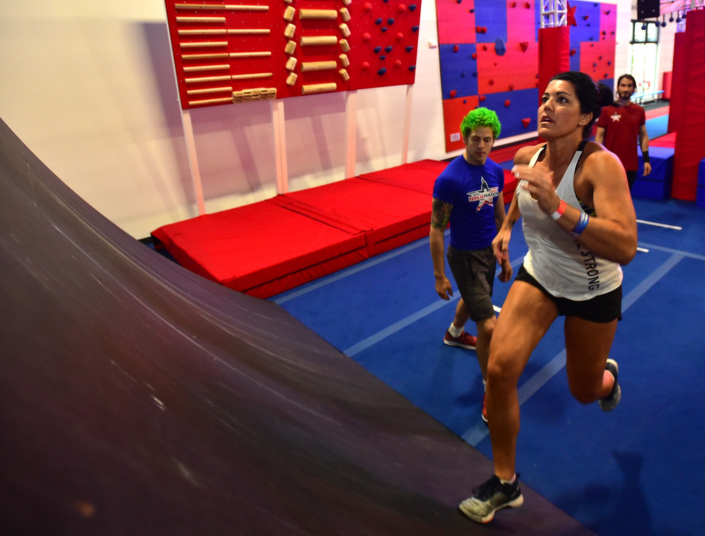 . Tate Fisher makes a run up the Warped Wall during the Adult Intro Class at Ninja Nation in Lafayette on Thursday.  Paul Aiken / Staff Photographer July 5, 2018