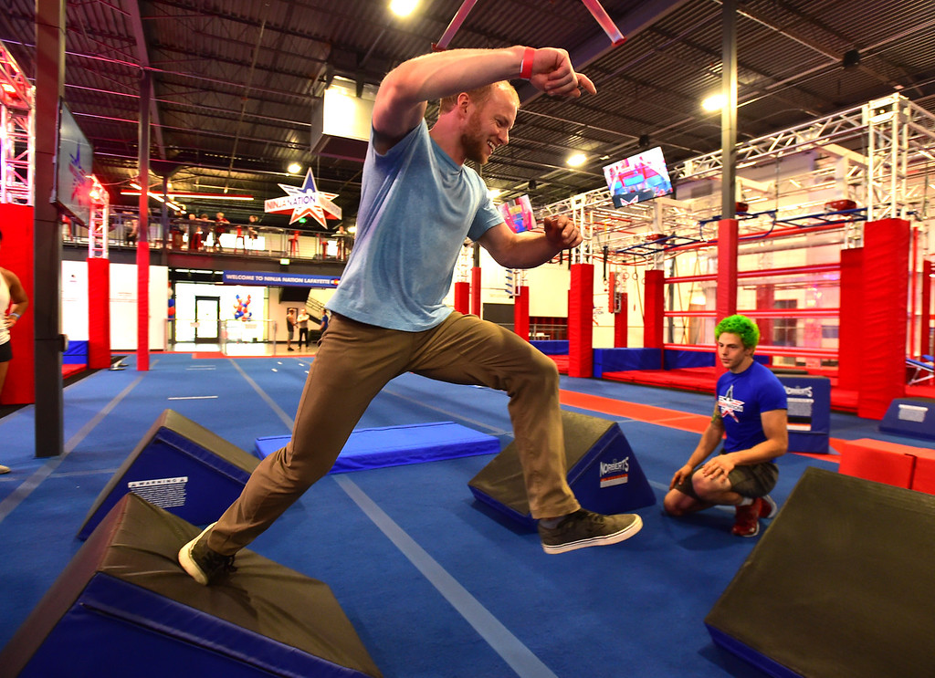 . Corey Morris makes a jump in the Quad Steps area during the Adult Intro Class at Ninja Nation in Lafayette on Thursday.  Paul Aiken / Staff Photographer July 5, 2018