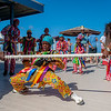 Here the young masqueraders show off their talent at limbo dancing!