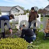 NIU freshman Olivia Portnov (from left), junior Mikala Kurzbuch and Somerset Farm resident Bonnie Rogers clean up a flower bed Saturday at the condominium community for seniors age 55 and older in Sycamore. Giving back to the community on Earth Day is an annual tradition for the sisters of Sigma Lambda Sigma service sorority. NIU students, faculty, staff and alumni volunteers spent the day planting, painting, cleaning, sorting and assisting with events and various other tasks around the county as part of NIU Cares Day.