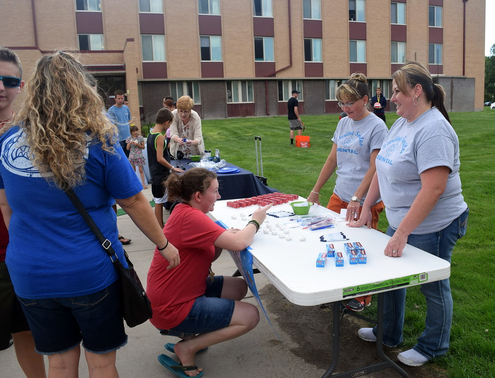 . Students and families get information about Sterling Smiles Dental and Colorado Christian University Thursday, Aug. 17, 2017, at Northeastern Junior College\'s BBQ and Community Club Fair, part of the college\'s move-in day activities.