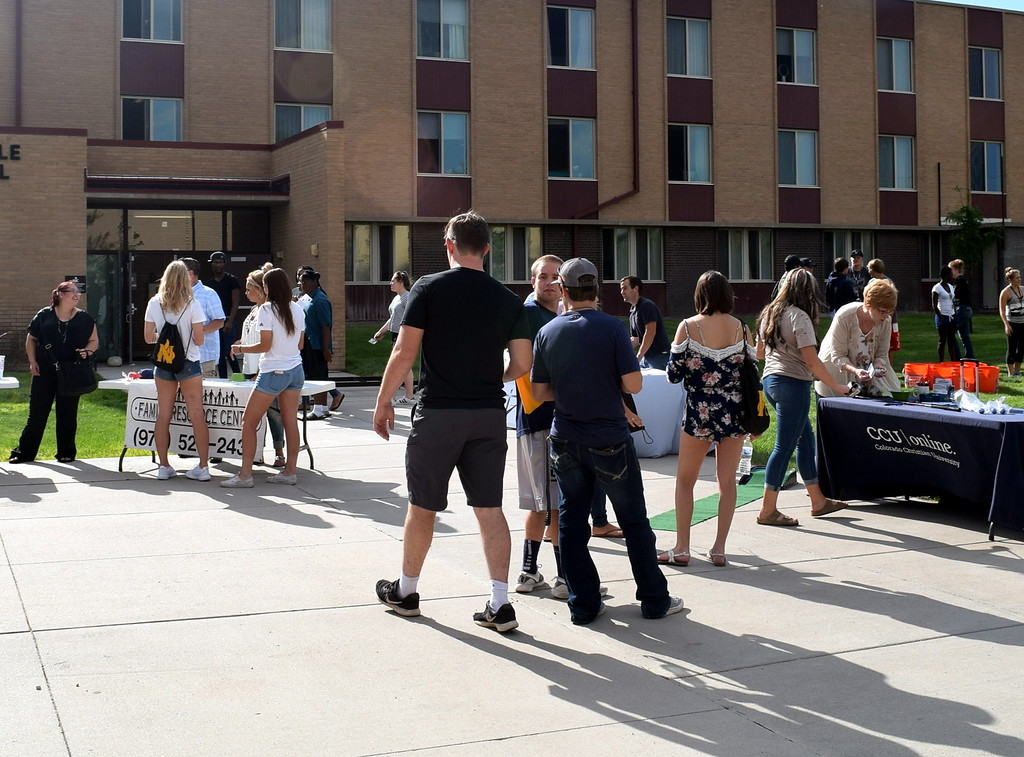 . Students and families browse the various booths Thursday, Aug. 17, 2017, at Northeastern Junior College\'s BBQ and Community Club Fair, part of the college\'s move-in day activities.