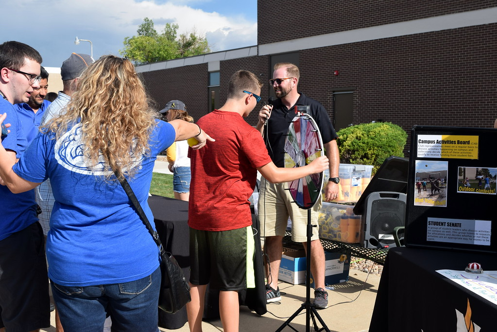 . Students and families were invited to spin the wheel to win a variety of NJC gear Thursday, Aug. 17, 2017, at Northeastern Junior College\'s BBQ and Community Club Fair, part of the college\'s move-in day activities.