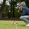 North Middlesex Regional High School men's golf hosted  Clinton High School on Thursday, Oct. 3, 2019 at Townsend Ridge Country Club. NMRHS's senior Nick Miller checks out the green before his putt during the match. SENTINEL & ENTERPRISE/JOHN LOVE