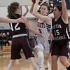 North Middlesex Regional High School girls basketball played Groton Dunstable Regional High School on Saturday in Townsend. NM's #3 Katie Kleeman tries to squeeze by GD's #12 Lauren Hill and #15 Katie Eberhardt. SENTINEL & ENTERPRISE/JOHN LOVE