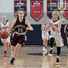 North Middlesex Regional High School girls basketball played Groton Dunstable Regional High School on Saturday in Townsend. GD's # 25Regan Gilmore has a breakaway. chasing after her is NM's #5 Gabby Durham. SENTINEL & ENTERPRISE/JOHN LOVE