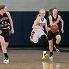 North Middlesex Regional High School girls basketball played Groton Dunstable Regional High School on Saturday in Townsend. NM's #5 Gabby Durham takes off down court. Keeping up with her is GD's #22 Jillian Van Pelt. SENTINEL & ENTERPRISE/JOHN LOVE