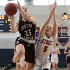North Middlesex Regional High School girls basketball played Groton Dunstable Regional High School on Saturday in Townsend. GD's # 25Regan Gilmore puts up a shot while covered by NM's #5 Gabby Durham. SENTINEL & ENTERPRISE/JOHN LOVE