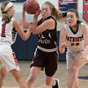 North Middlesex Regional High School girls basketball played Groton Dunstable Regional High School on Saturday in Townsend. NM's #11 Julia Landrey and #23 Sophia Couto cover GD's #22 Jillian Van Pelt as she drives to the basket. SENTINEL & ENTERPRISE/JOHN LOVE