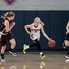 North Middlesex Regional High School girls basketball played Groton Dunstable Regional High School on Saturday in Townsend. NM's #5 Gabby Durham takes off down court. SENTINEL & ENTERPRISE/JOHN LOVE