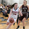 North Middlesex Regional High School girls basketball played Groton Dunstable Regional High School on Saturday in Townsend. NM's #23 Sophia Couto drives by GD's #21 Bronwyn Mulligan as she drives to the basket. SENTINEL & ENTERPRISE/JOHN LOVE