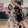 North Middlesex Regional High School girls basketball played Groton Dunstable Regional High School on Saturday in Townsend. GD's #15 Katie Eberhardt covers NM's #3 Katie Kleeman as she drives to the basket. SENTINEL & ENTERPRISE/JOHN LOVE