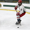 North Middlesex Regional High School hockey team played Groton Dunstable Regional High School at the Wallace Civic Center on Wednesday, Feb. 12, 2020 in Fitchburg. NMRHS's #3 Sean Morrissey with the puck behind his net. SENTINEL & ENTERPRISE/JOHN LOVE