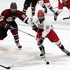 North Middlesex Regional High School hockey team played Groton Dunstable Regional High School at the Wallace Civic Center on Wednesday, Feb. 12, 2020 in Fitchburg. GD's #20 Nate Glencross chase after NM's #11 Jimmy O'keefe. SENTINEL & ENTERPRISE/JOHN LOVE
