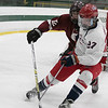 North Middlesex Regional High School hockey team played Groton Dunstable Regional High School at the Wallace Civic Center on Wednesday, Feb. 12, 2020 in Fitchburg. NM #27 Caleb Amidon and GD's #12 Ian Maguire. SENTINEL & ENTERPRISE/JOHN LOVE