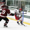 North Middlesex Regional High School hockey team played Groton Dunstable Regional High School at the Wallace Civic Center on Wednesday, Feb. 12, 2020 in Fitchburg. GD's  #19 TJ Sannazzaro and with puck NM's #6 Ryan Lavery. SENTINEL & ENTERPRISE/JOHN LOVE