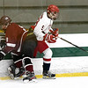 North Middlesex Regional High School hockey team played Groton Dunstable Regional High School at the Wallace Civic Center on Wednesday, Feb. 12, 2020 in Fitchburg. GD's #8 Mike Hamill tries to check NM's #9 William Morrissey. SENTINEL & ENTERPRISE/JOHN LOVE