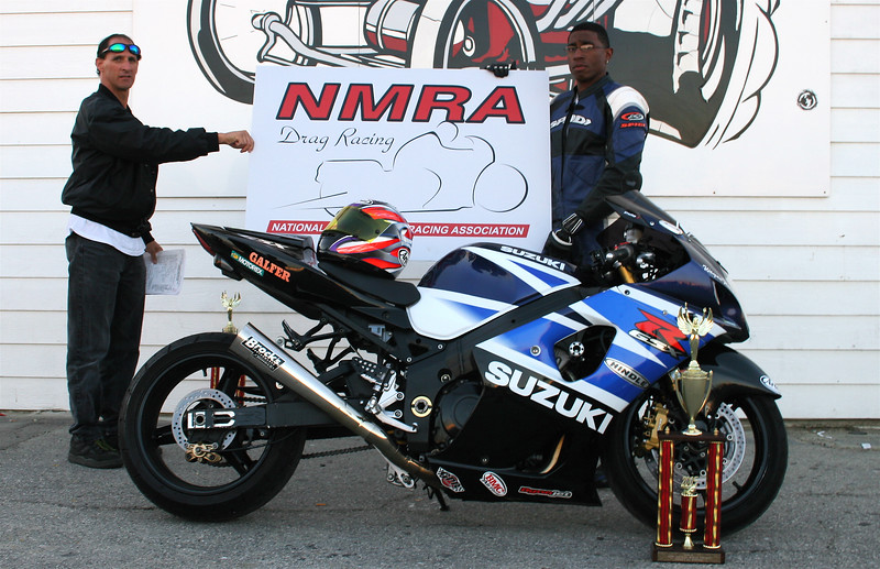 """STREET  E/T - WINNER: WAYNE FLETCHER  10.10  @ 139 MPH  <div class=""""ss-paypal-button""""><div class=""""fancy-paypal-box"""">  <div class=""""left-side"""">   <div class=""""ss-paypal-add-to-cart-section""""><div class=""""ss-paypal-product-options""""> <h4>PRICES inc. Ship/Hand:</h4> <ul> <li><a href=""""https://www.paypal.com/cgi-bin/webscr?cmd=_cart&amp;business=BZRZ3VMEMKS5E&amp;lc=US&amp;item_name=STREET%20%20E%2FT%20-%20WINNER%3A%20WAYNE%20FLETCHER%20%2010.10%20%20%40%20139%20MPH&amp;item_number=http%3A%2F%2Fwww.hooliganunderground.com%2FNMRA%2FNMRA-15th-ANNUAL-WORLD-FINALS%2Fi-rGscptK&amp;button_subtype=products&amp;no_note=0&amp;cn=Add%20special%20instructions%20to%20the%20seller%3A&amp;no_shipping=2&amp;currency_code=USD&amp;tax_rate=9.750&amp;add=1&amp;bn=PP-ShopCartBF%3Abtn_cart_LG.gif%3ANonHosted&amp;on0=PRICES%20inc.%20Ship%2FHand%3A&amp;option_select0=Digital%20for%20web&amp;option_amount0=5.95&amp;option_select1=8.5%20x%2011%22%20glossy&amp;option_amount1=19.95&amp;option_select2=12%20x%2018%22%20lustre&amp;option_amount2=49.95&amp;option_select3=20%20x%2030%22%20lustre&amp;option_amount3=69.95&amp;option_index=0&amp;submit=&amp;os0=Digital%20for%20web"""" target=""""paypal""""><span>Digital for web $ 5.95 USD</span><img src=""""https://www.paypalobjects.com/en_US/i/btn/btn_cart_SM.gif""""></a></li> <li><a href=""""https://www.paypal.com/cgi-bin/webscr?cmd=_cart&amp;business=BZRZ3VMEMKS5E&amp;lc=US&amp;item_name=STREET%20%20E%2FT%20-%20WINNER%3A%20WAYNE%20FLETCHER%20%2010.10%20%20%40%20139%20MPH&amp;item_number=http%3A%2F%2Fwww.hooliganunderground.com%2FNMRA%2FNMRA-15th-ANNUAL-WORLD-FINALS%2Fi-rGscptK&amp;button_subtype=products&amp;no_note=0&amp;cn=Add%20special%20instructions%20to%20the%20seller%3A&amp;no_shipping=2&amp;currency_code=USD&amp;tax_rate=9.750&amp;add=1&amp;bn=PP-ShopCartBF%3Abtn_cart_LG.gif%3ANonHosted&amp;on0=PRICES%20inc.%20Ship%2FHand%3A&amp;option_select0=Digital%20for%20web&amp;option_amount0=5.95&amp;option_select1=8.5%20x%2011%22%20glossy&amp;option_amount1=19.95&amp;option_s"""