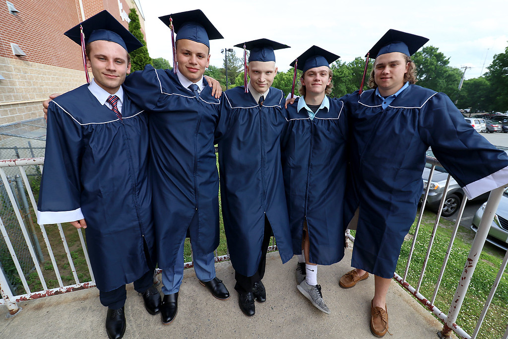 . North Middlesex Regional High School held its 57th commencement exercises on June 1, 2018 at Fitchburg State University Recreation Center. Some scenes from the graduation. Graduates, from left, Tyler Aprahamian, Jean Arevalo, Nicholas Dumont, Matt Brown and Connor Clermont wait for the ceremony to start. SENTINEL & ENTERPRISE/JOHN LOVE