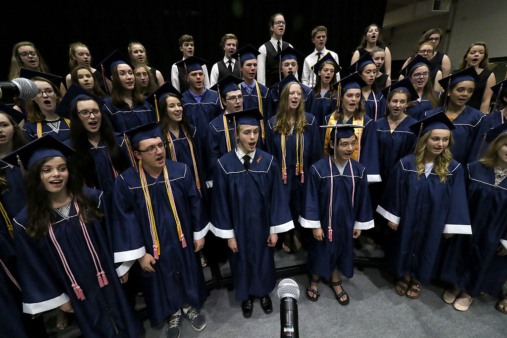. North Middlesex Regional High School held its 57th commencement exercises on June 1, 2018 at Fitchburg State University Recreation Center. Graduates sing the school song with the NMRHS choirs. SENTINEL & ENTERPRISE/JOHN LOVE