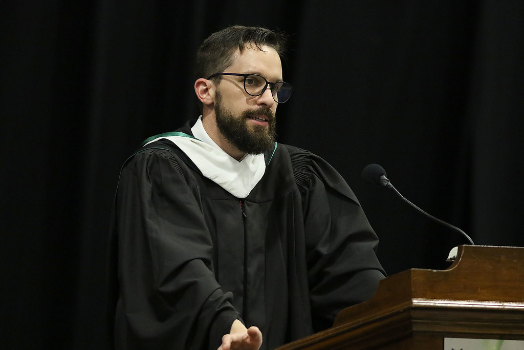 . North Middlesex Regional High School held its 57th commencement exercises on June 1, 2018 at Fitchburg State University Recreation Center. Principal Isaac Taylor addresses the class at the ceremony. SENTINEL & ENTERPRISE/JOHN LOVE