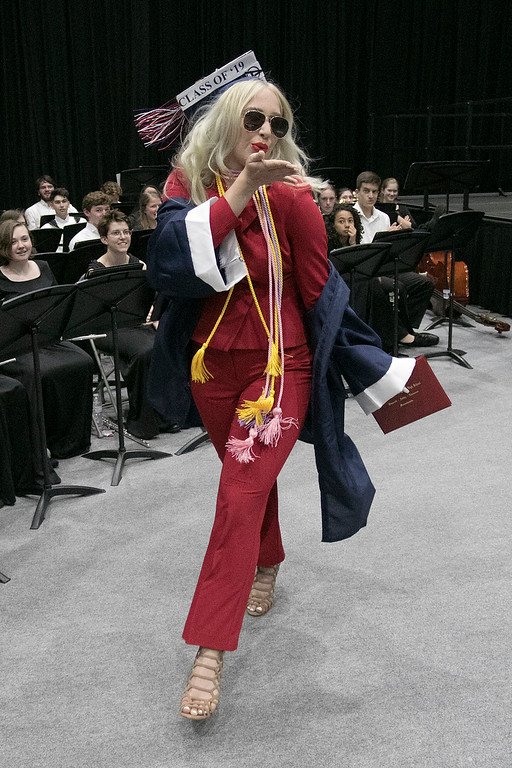 . North Middlesex Regional High School graduation was held on Friday night at Fitchburg State University Recreation Center. Graduate Abigail Thompson blows a kiss to her classmates as she makes her way to her seat after getting her diploma. SENTINEL & ENTERPRISE/JOHN LOVE
