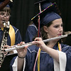 North Middlesex Regional High School graduation was held on Friday night at Fitchburg State University Recreation Center. Graduate Alayne Mazzarini plays the flute with the school band during the ceremony. SENTINEL & ENTERPRISE/JOHN LOVE