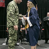 North Middlesex Regional High School graduation was held on Friday night at Fitchburg State University Recreation Center. Graduate Madison Davis was shocked when she heard that Navy Petty Officer Zachary Davis, a graduate of NMRHS in 2014, her brother was going to give her her diploma. They chat for a minute on stage after he gave her her diploma. SENTINEL & ENTERPRISE/JOHN LOVE