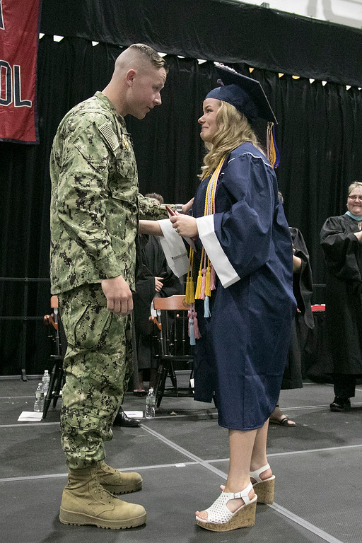 . North Middlesex Regional High School graduation was held on Friday night at Fitchburg State University Recreation Center. Graduate Madison Davis was shocked when she heard that Navy Petty Officer Zachary Davis, a graduate of NMRHS in 2014, her brother was going to give her her diploma. They chat for a minute on stage after he gave her her diploma. SENTINEL & ENTERPRISE/JOHN LOVE
