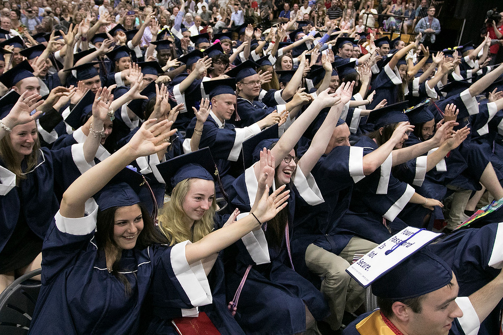 . North Middlesex Regional High School graduation was held on Friday night at Fitchburg State University Recreation Center. Graduates do a wave just before they threw their caps at the end of the ceremony. SENTINEL & ENTERPRISE/JOHN LOVE